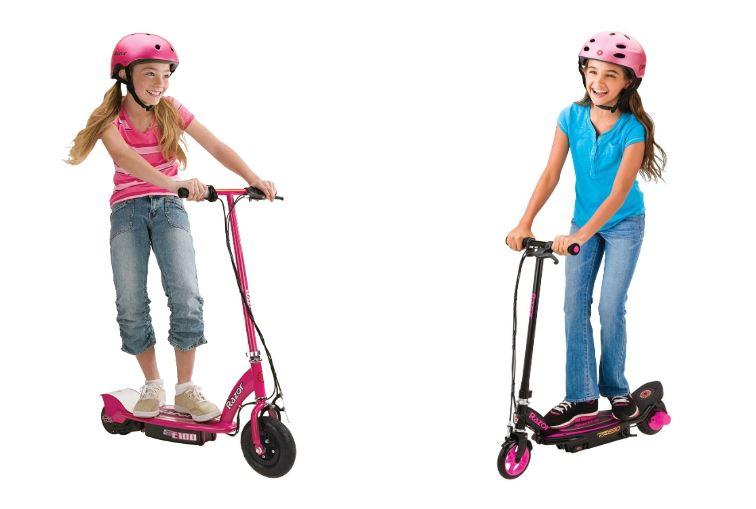 Niñas montando en patinetes eléctricos de color rosa
